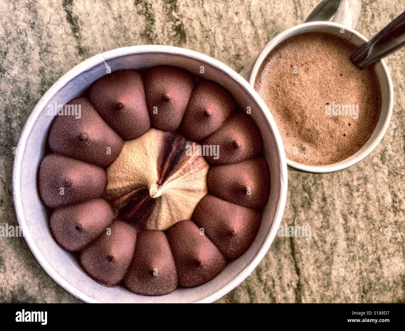Chocolate and vanilla ice cream and cup of cappuccino - Stock Image