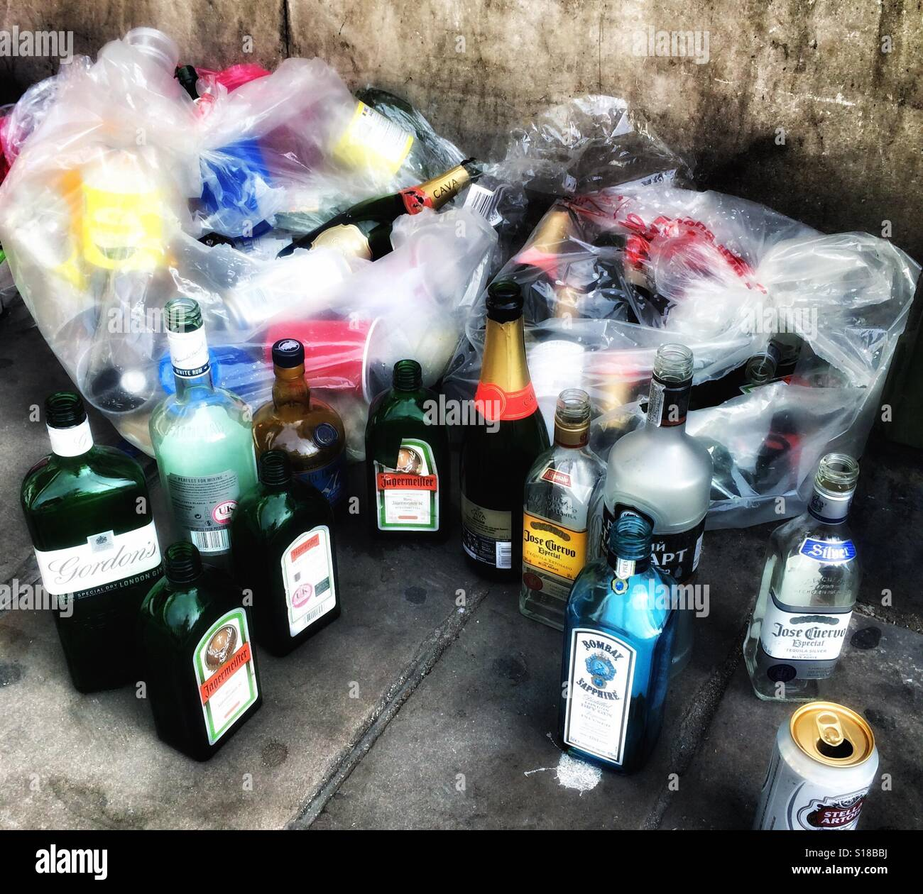 Empty bottles out for rubbish collection Stock Photo