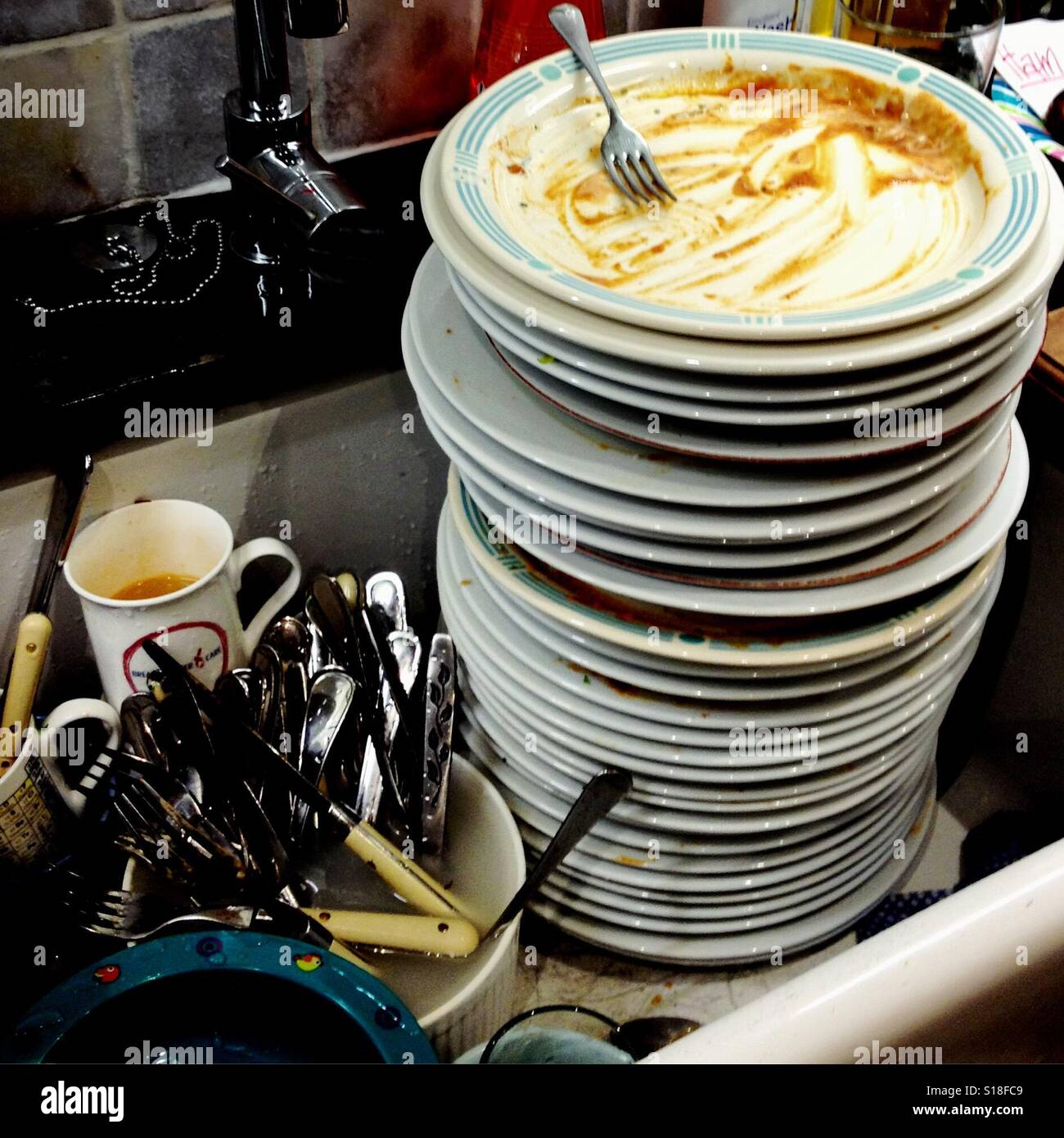 Messy Kitchen Sink Stock Photos: Large Pile Of Dirty Washing Up In The Kitchen Sink Stock