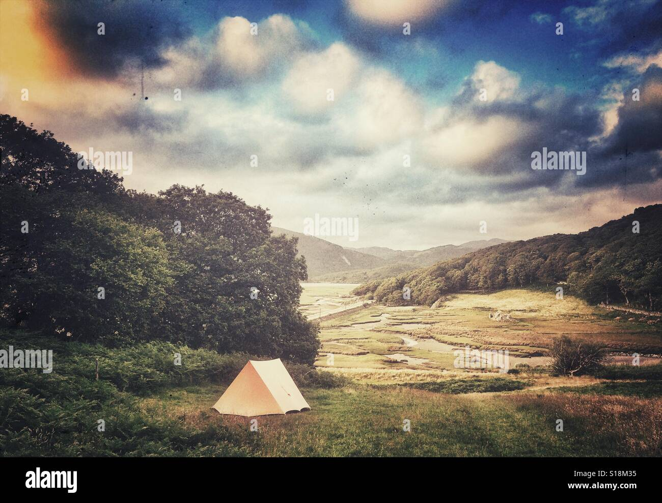 A single tent in a field near Barmouth, Wales - Stock Image