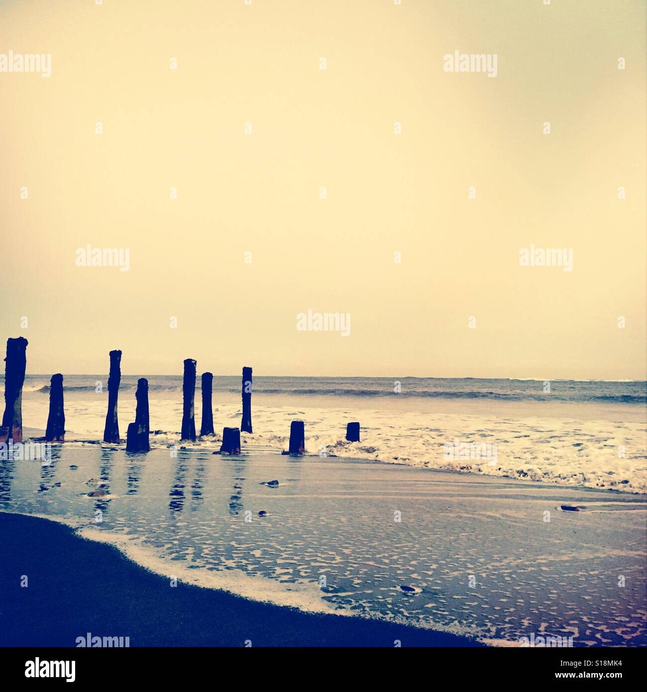Gentle waves in winter at Spurn Point Humberside UK - Stock Image