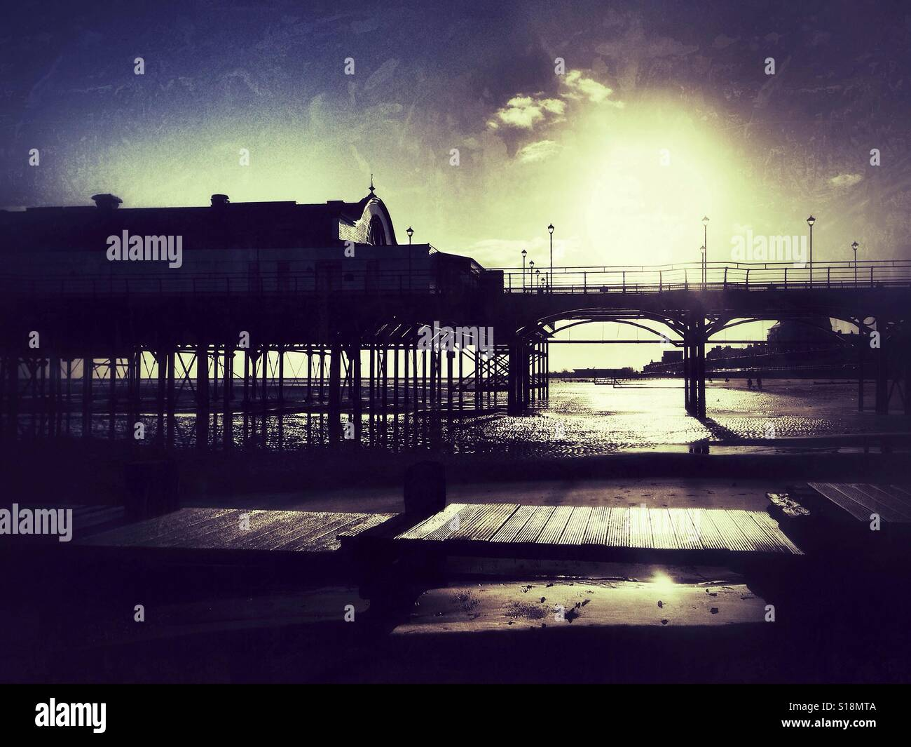 Traditional pier at sunrise. - Stock Image