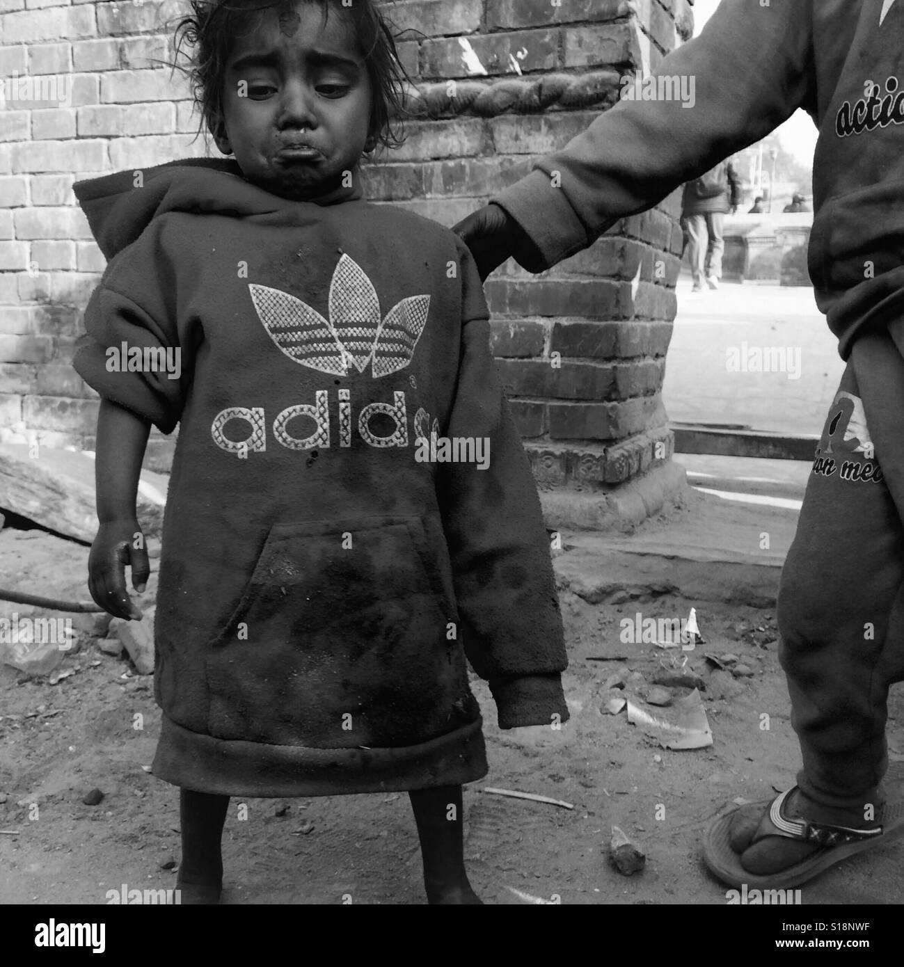 Little girl in an adidas top, Kathmandu - Stock Image