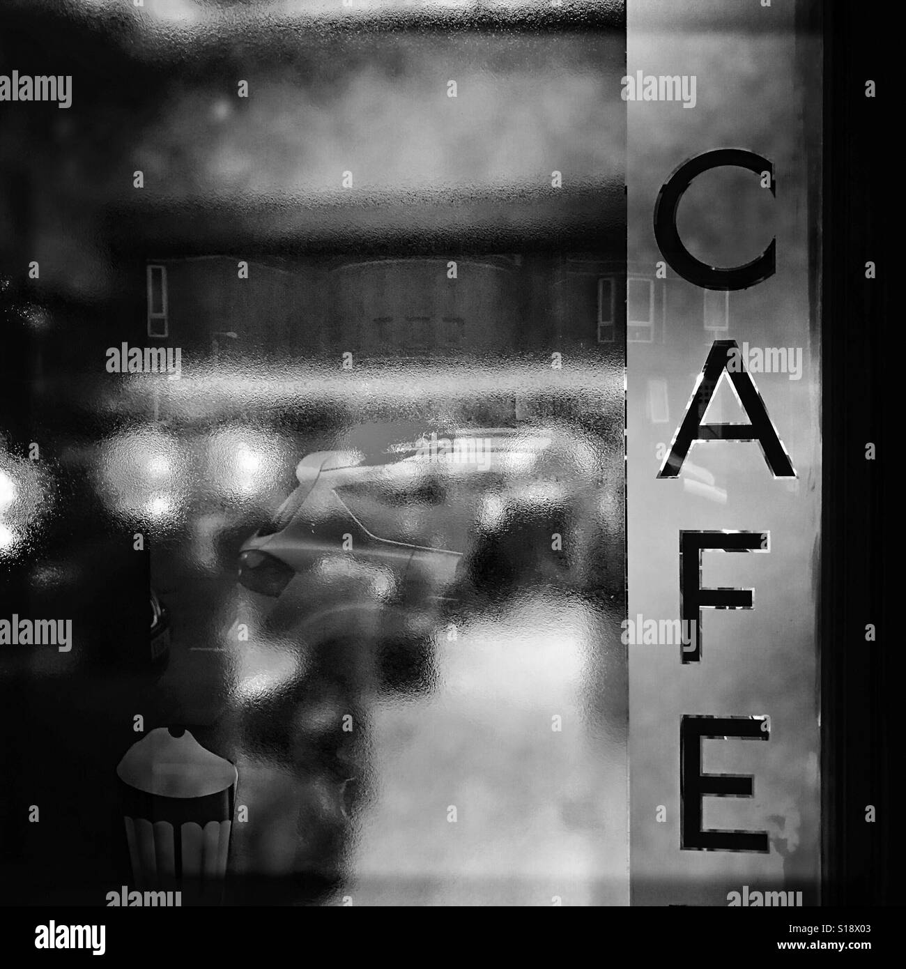 Logo on the glass door of a traditional Glasgow Cafe. - Stock Image