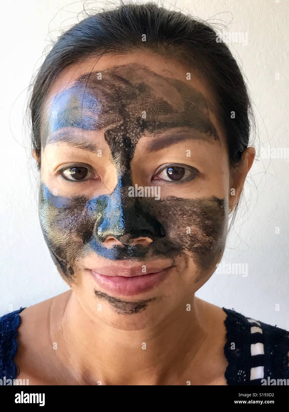 Woman with anti aging face mask beauty treatment - Stock Image