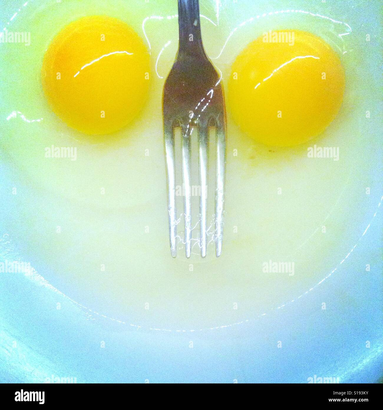 Smile on objects. A pair of eggs and a fork Stock Photo