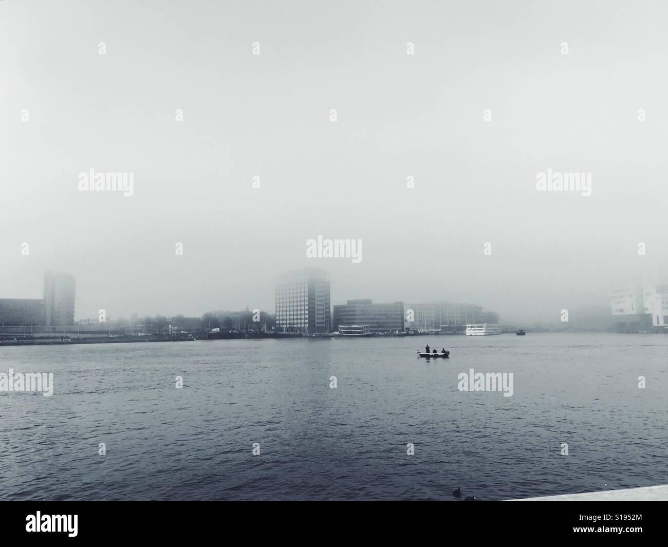 fog over the Ij river in Amsterdam - Stock Image