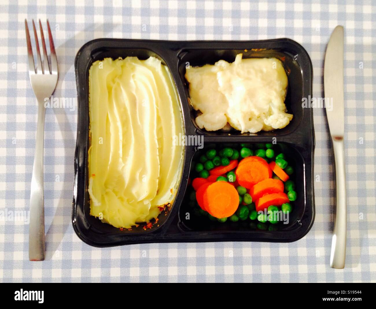 M&S meal for one cottage pie with cauliflower cheese, carrots and peas Stock Photo