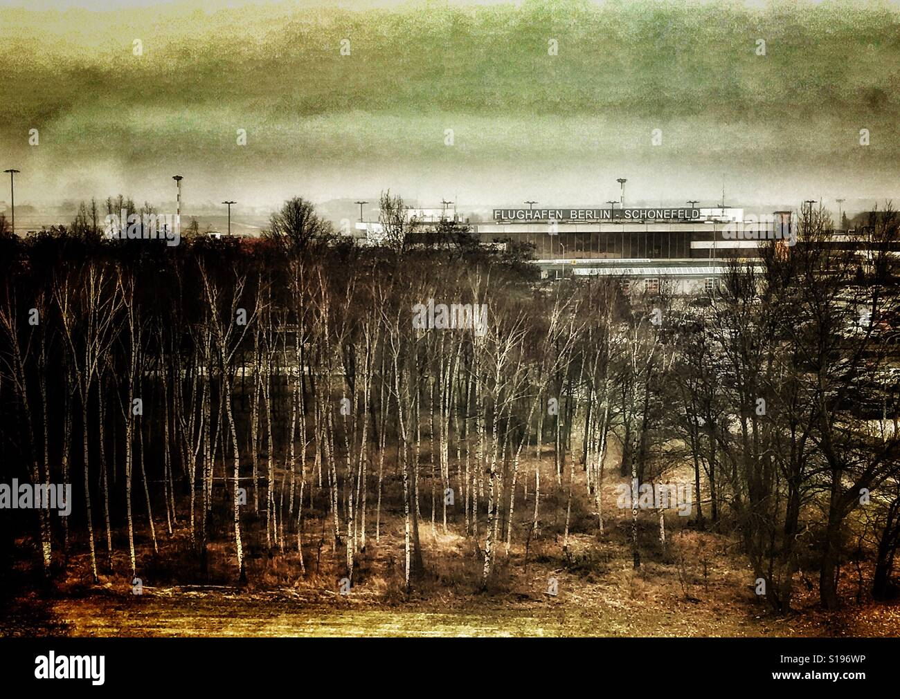 View from a hotel window shows a landscape with trees and the german airport ' Schonefeld ' in Berlin  ; - Stock Image