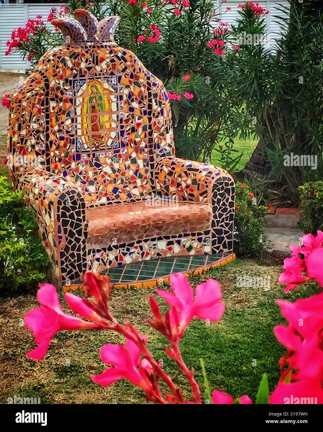 Sensational A Mosaic Tile Covered Concrete Chair Adorns A Garden In Inzonedesignstudio Interior Chair Design Inzonedesignstudiocom