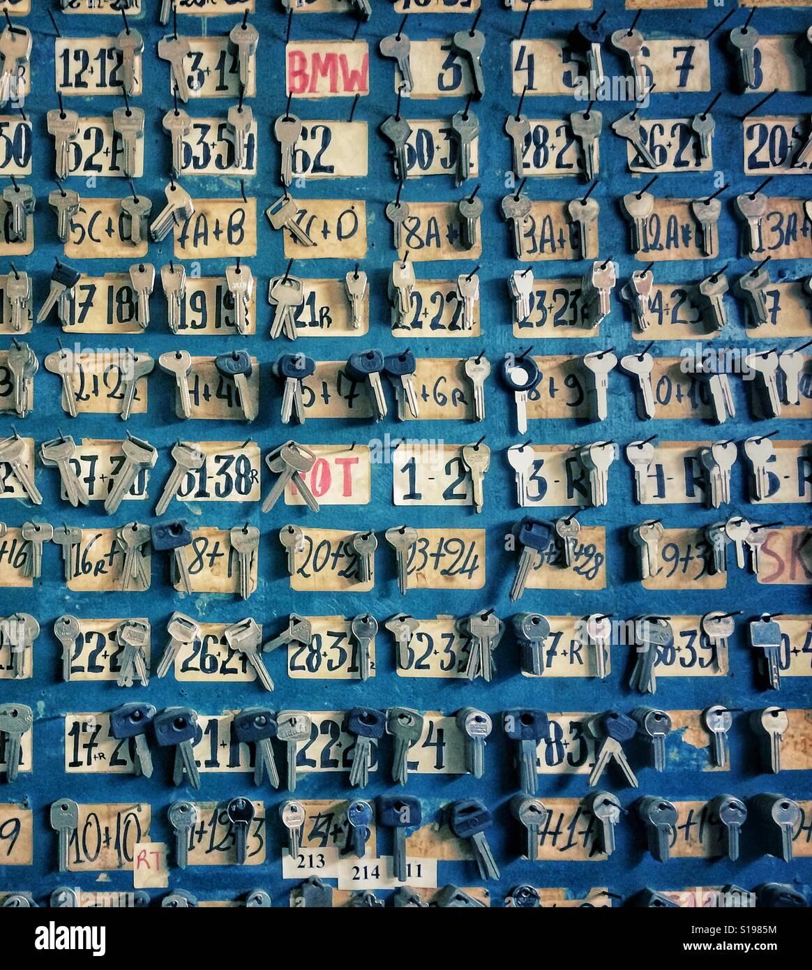Uncut keys on a wall close-up - Stock Image