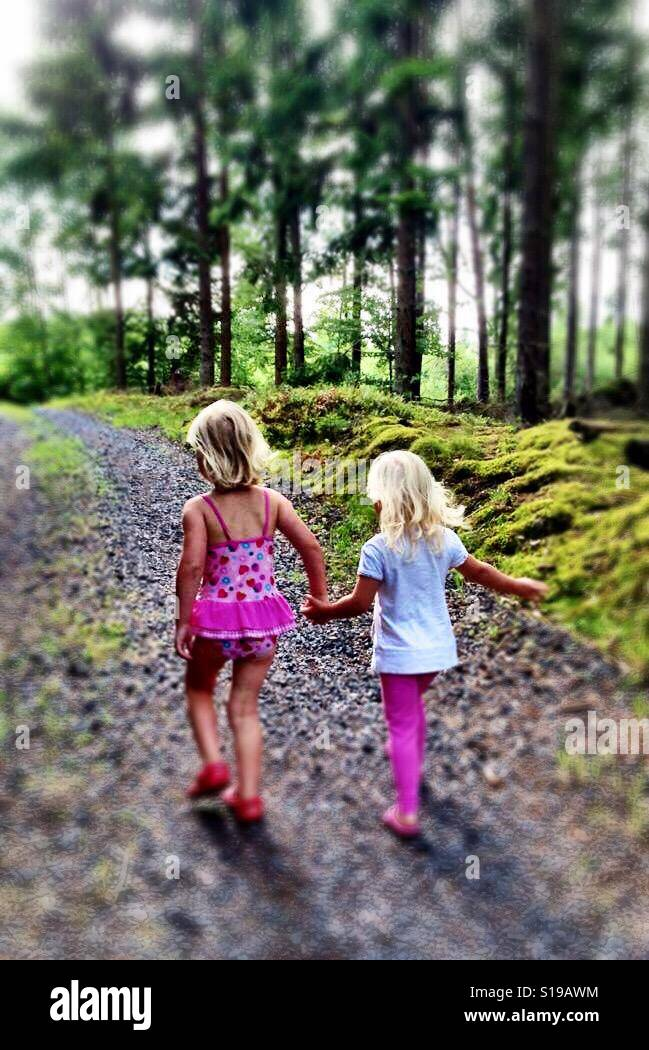 Cousin love walking through the Swedish forest... - Stock Image