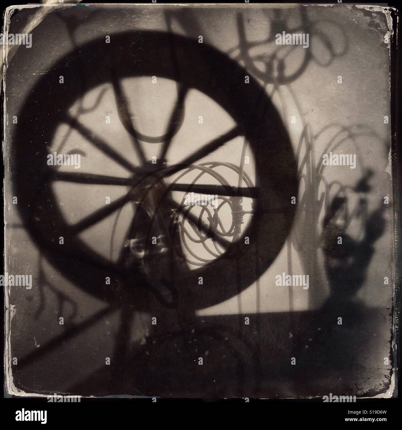 Stylized antique photograph of a spinning wheel used to spin thread Stock Photo