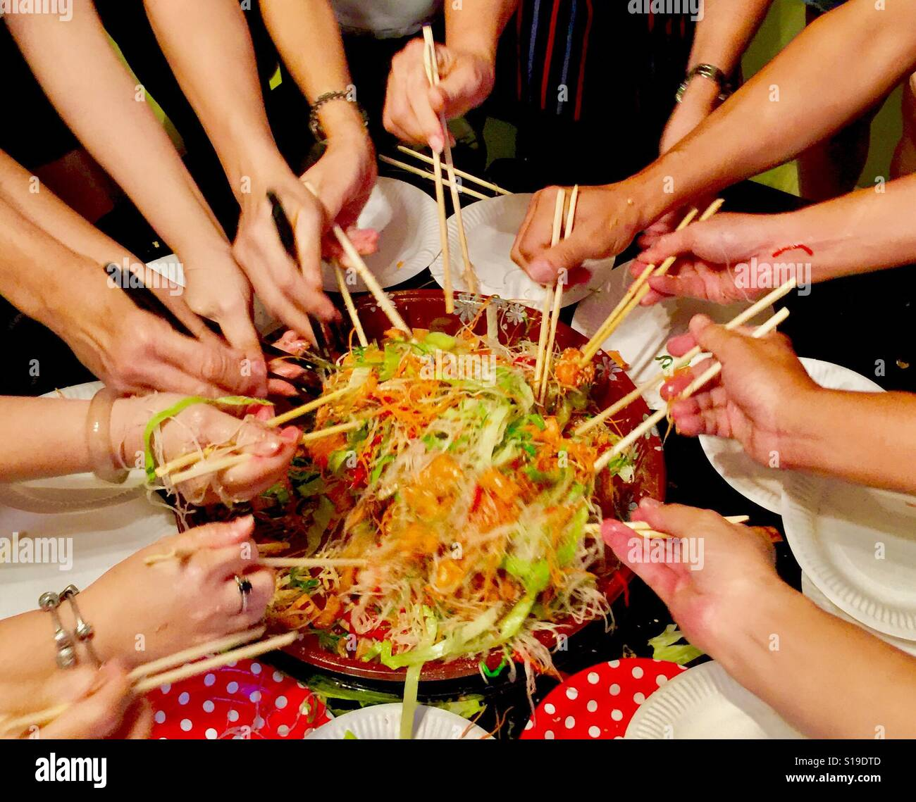 Auspicious Chinese New Year dish, Lo Hei Yu Sheng, tossing to prosperity, Singapore - Stock Image