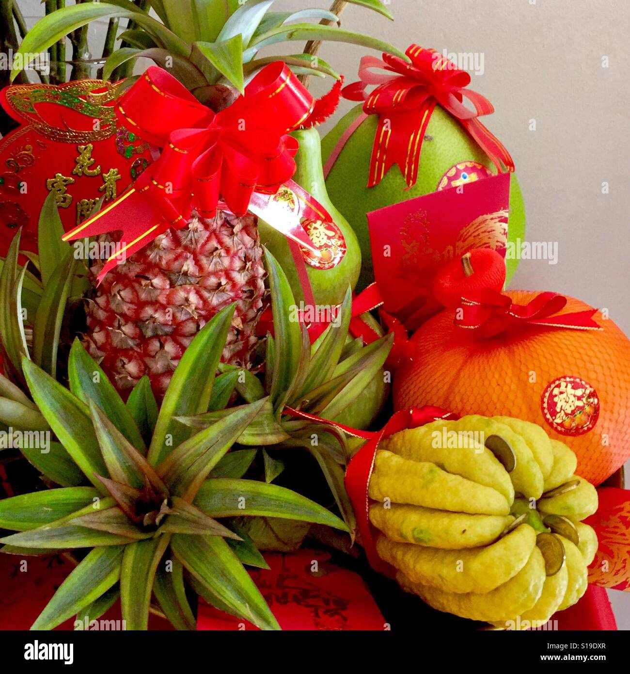 Auspicious Chinese New Year fruits  - Pineapple, Buddha's hand, Pumpkin, gourd  and pamelo - Stock Image