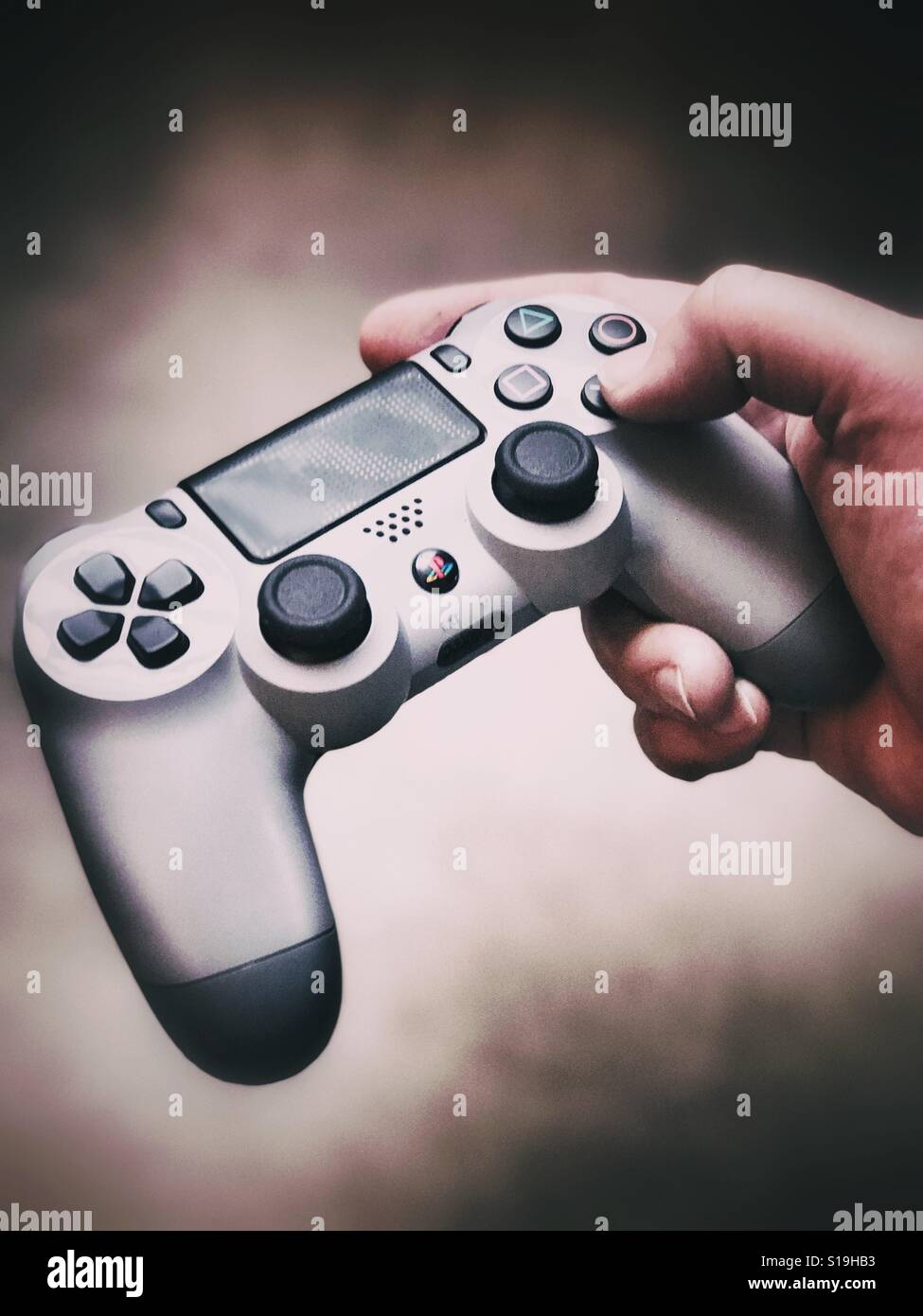 Holding A PlayStation Controller