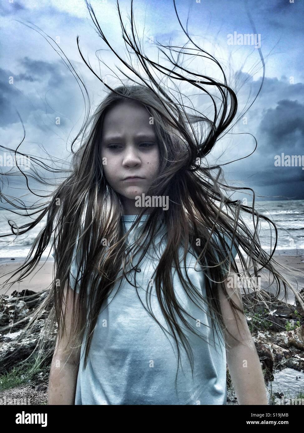 Moody tween girl. - Stock Image