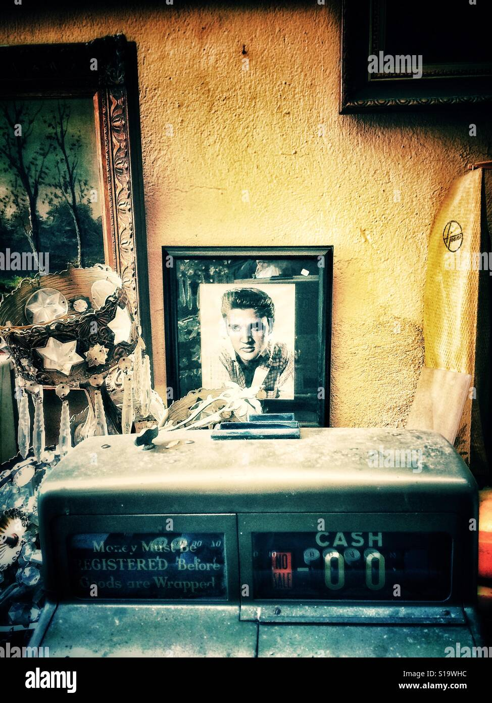 Framed photograph of Elvis Presley in an antique shop Stock Photo ...