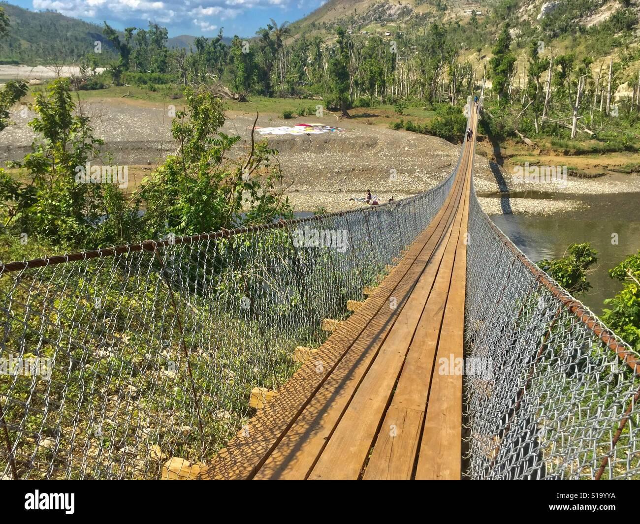 Catenary footbridge, Haiti Stock Photo