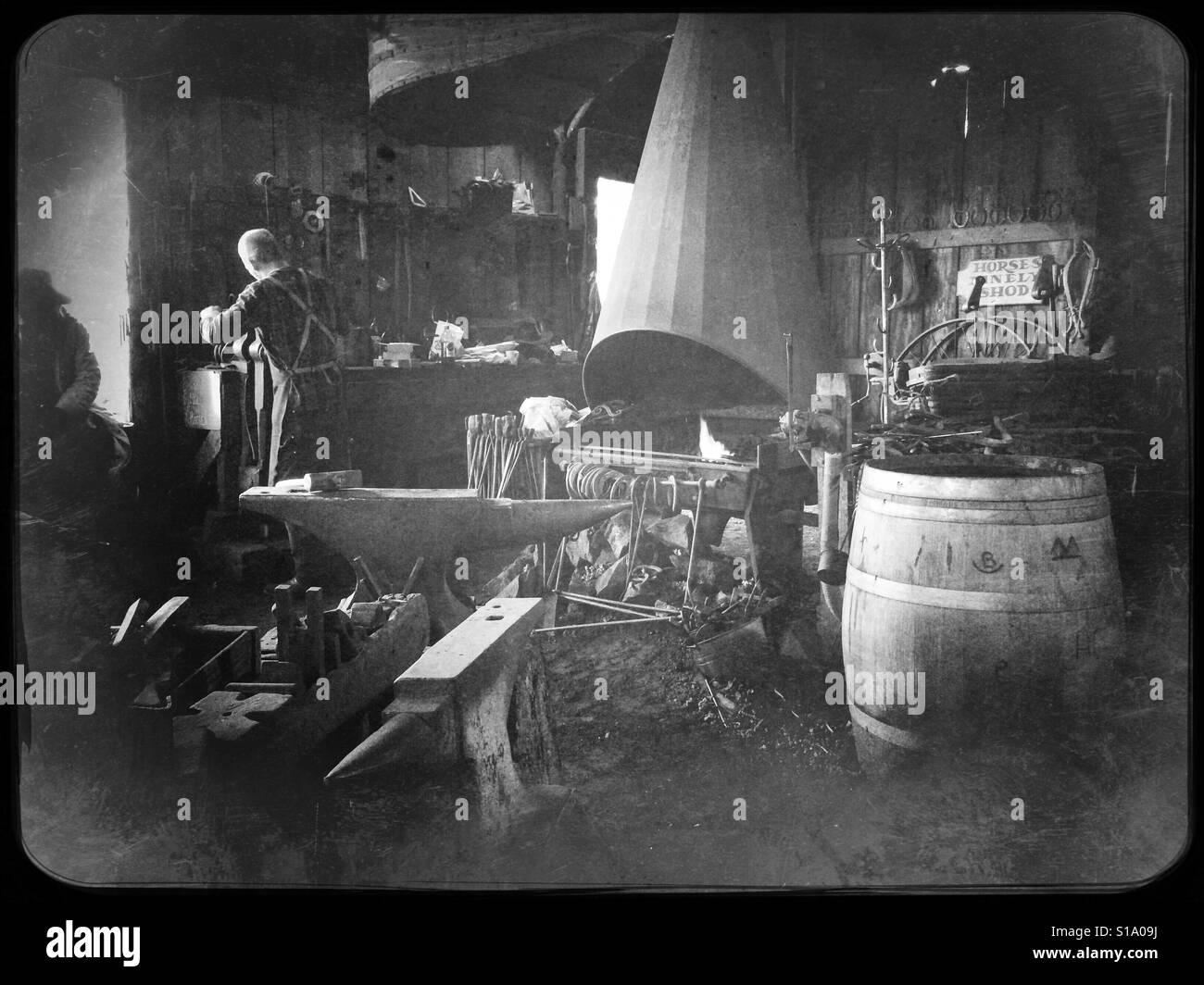 A blacksmith working in his shop on Main Street. Columbia State Historic Park, Columbia, Tuolumne County,  California, - Stock Image
