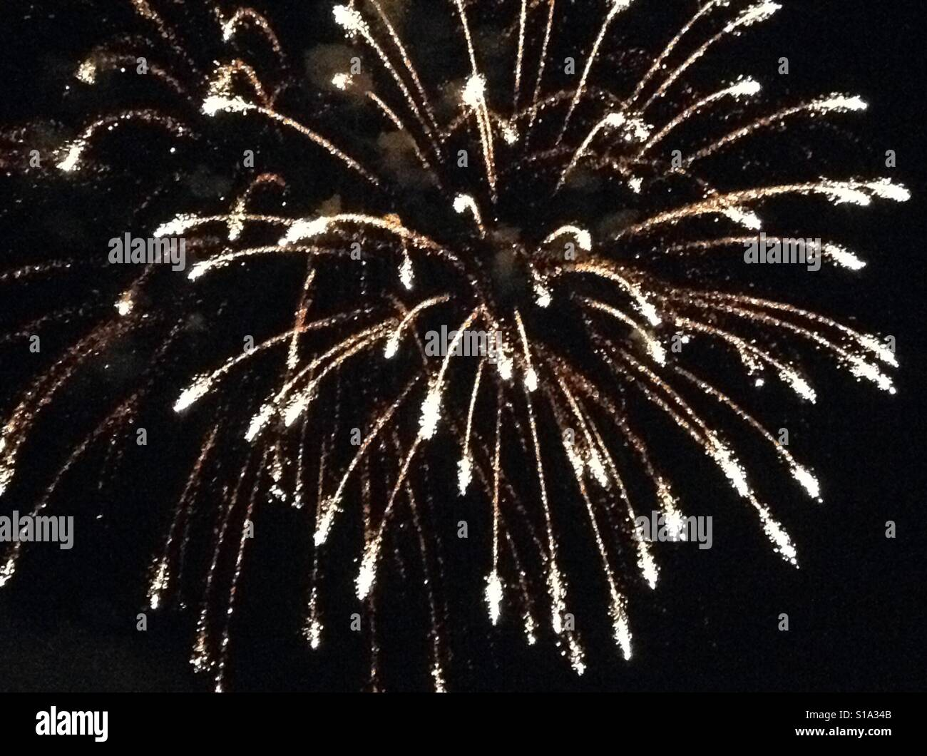 Bursting sparkling night fireworks - Stock Image