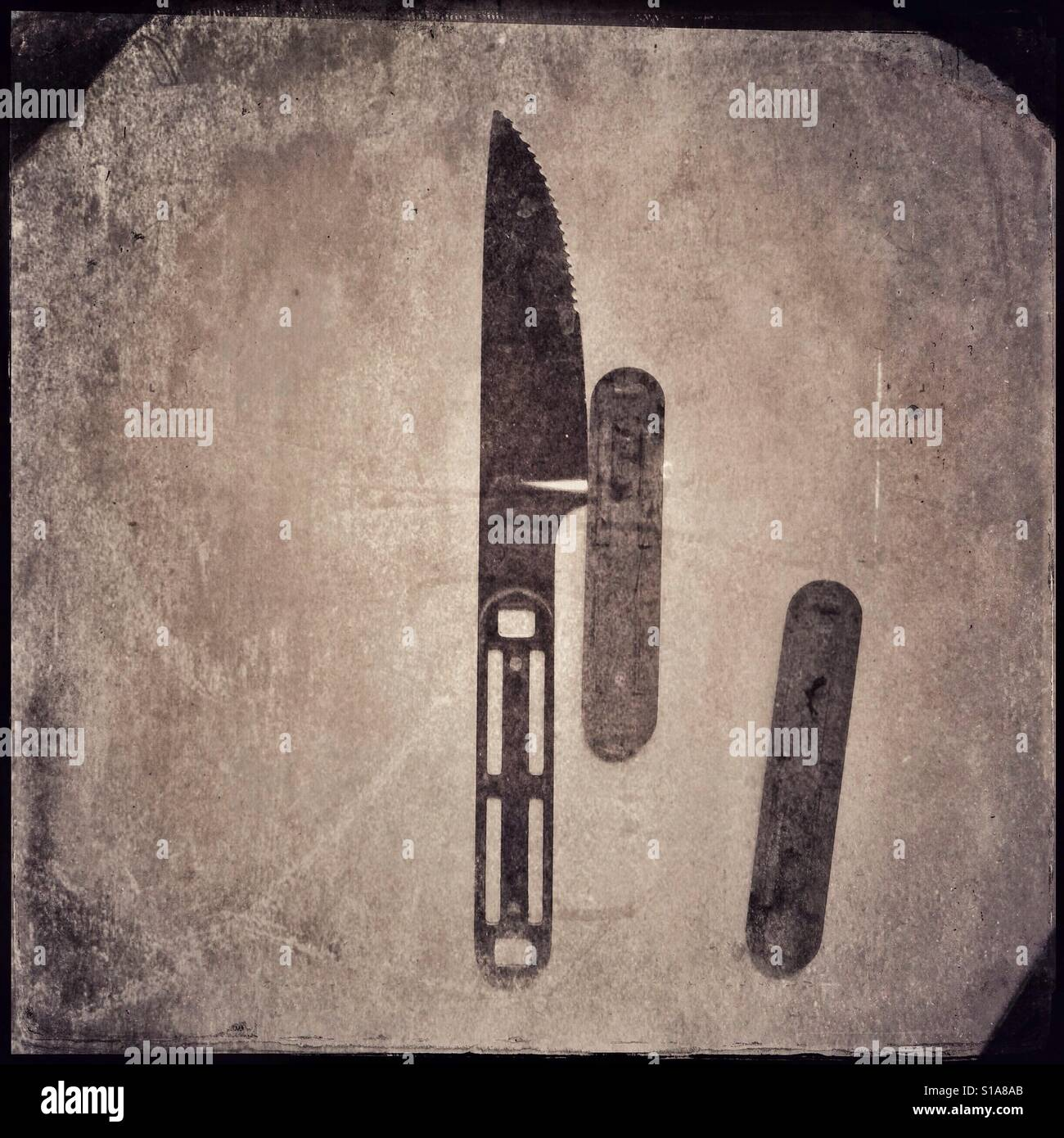 Parts of a disassembled knife still life - Stock Image