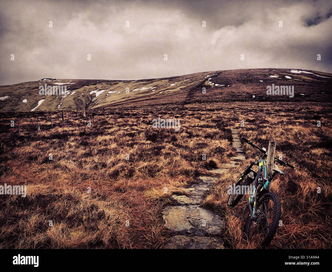 A mountain bike on the Pennine Way in the Cheviot Hills on the Anglo Scottish border - Stock Image