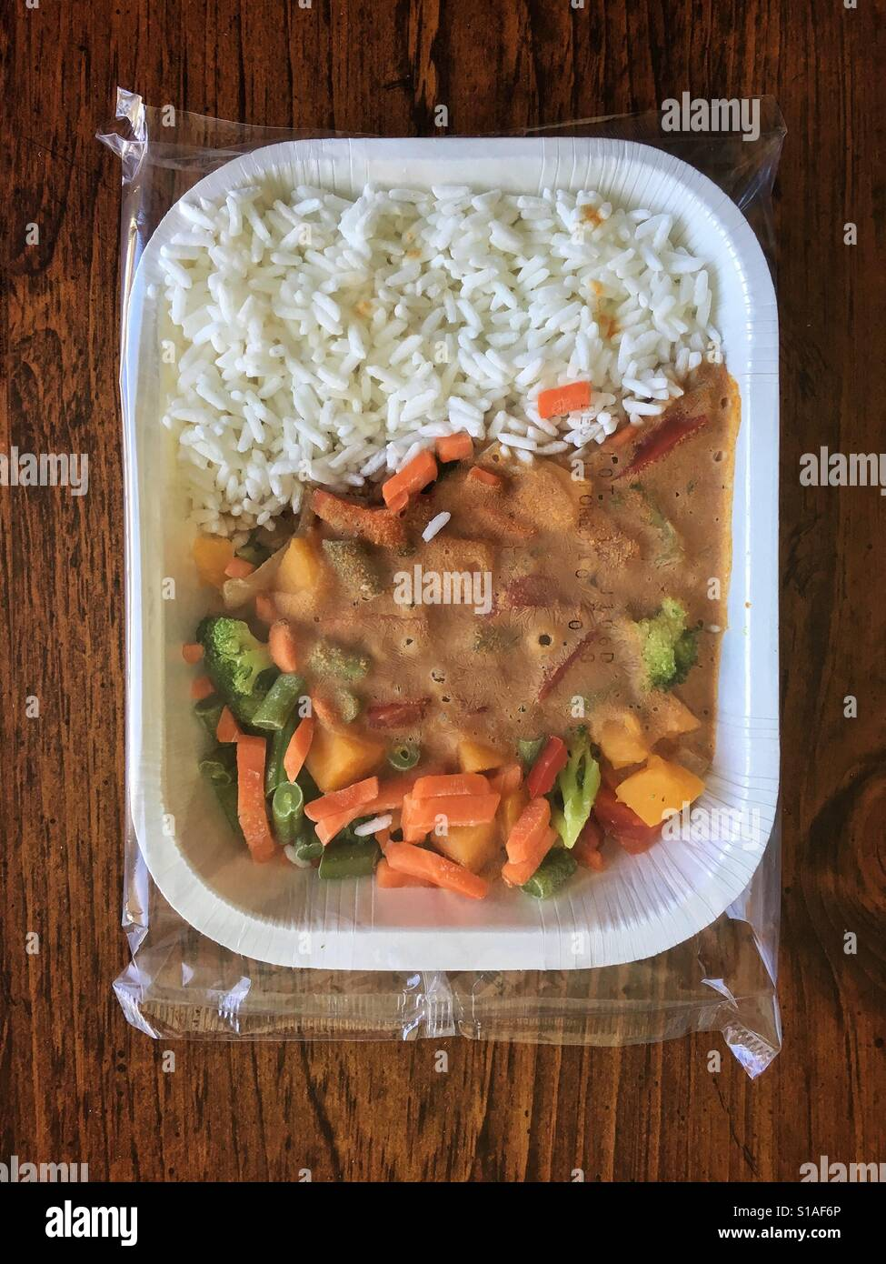 Microwave dinner curry and rice - Stock Image