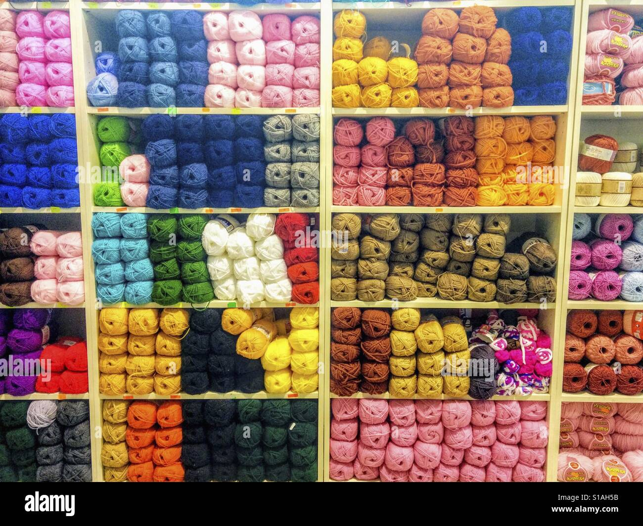 Skeins of wool for sale. - Stock Image