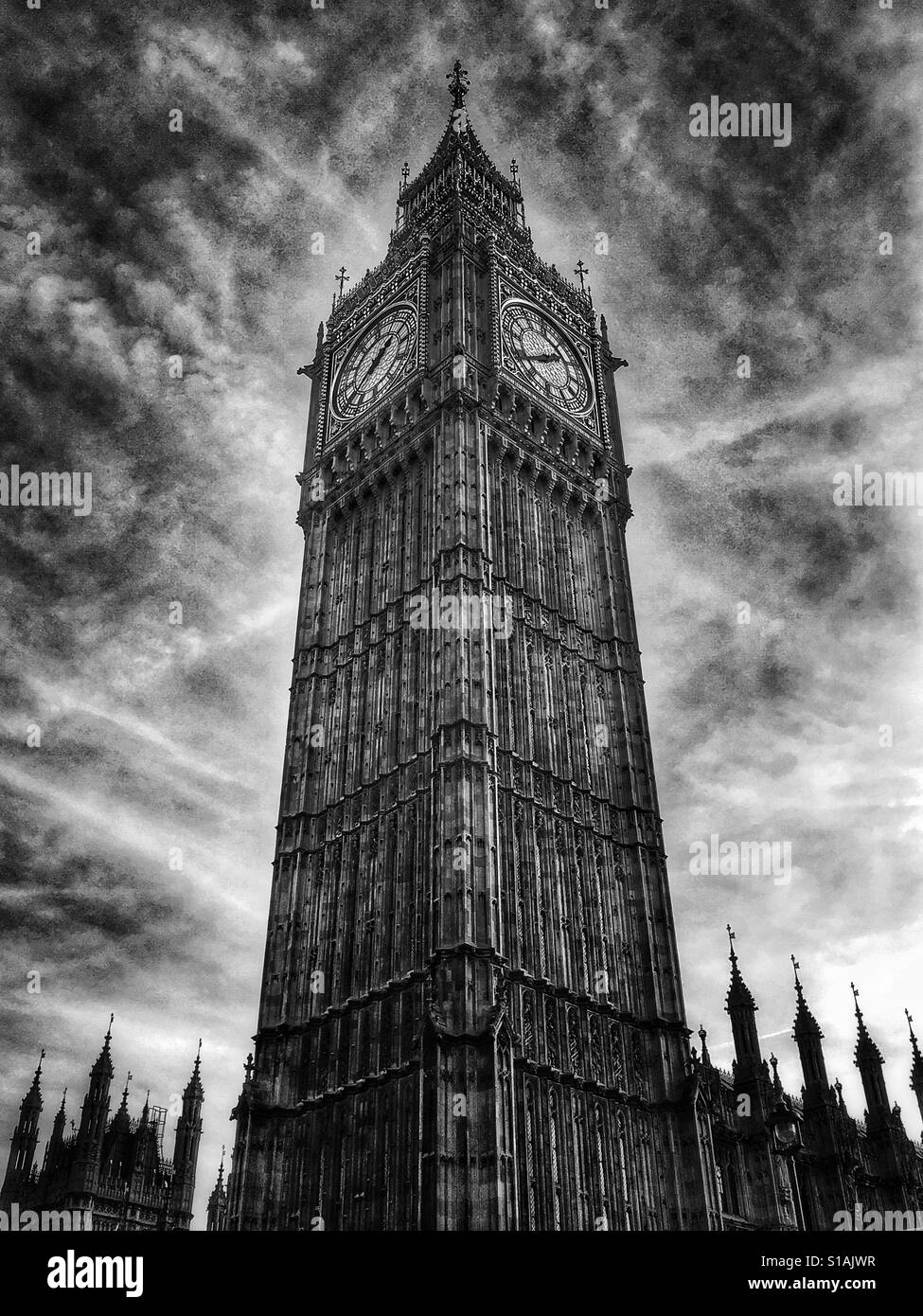 Black and white photo of Elizabeth Tower, more commonly known as Big Ben, under a dramatic sky in Westminster, London, - Stock Image