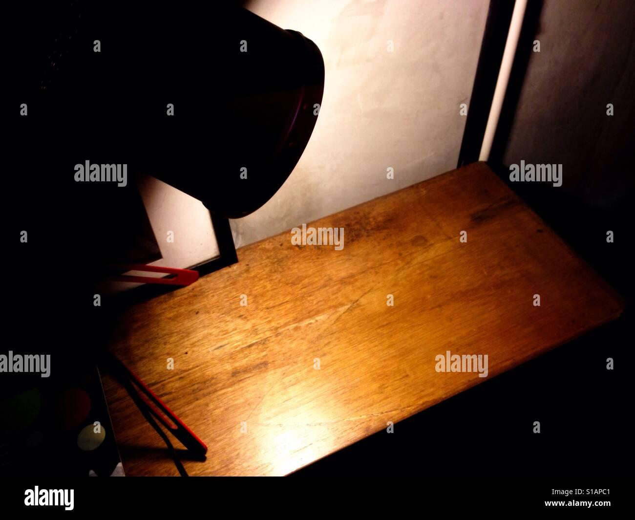 lights illuminate the empty wood table - Stock Image