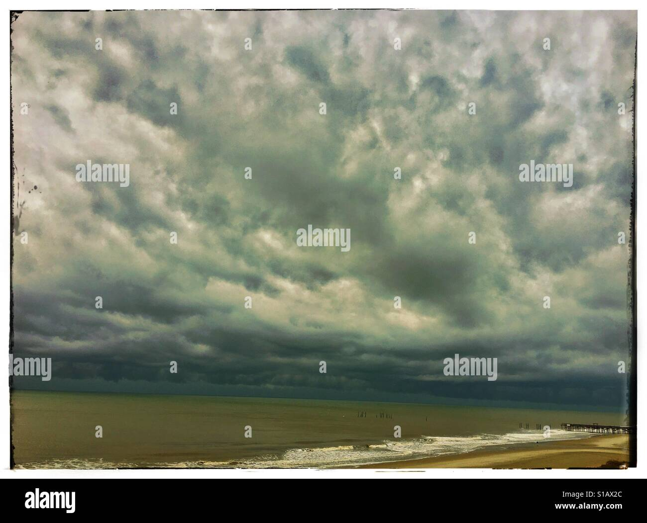 Stormy clouds at the beach - Stock Image