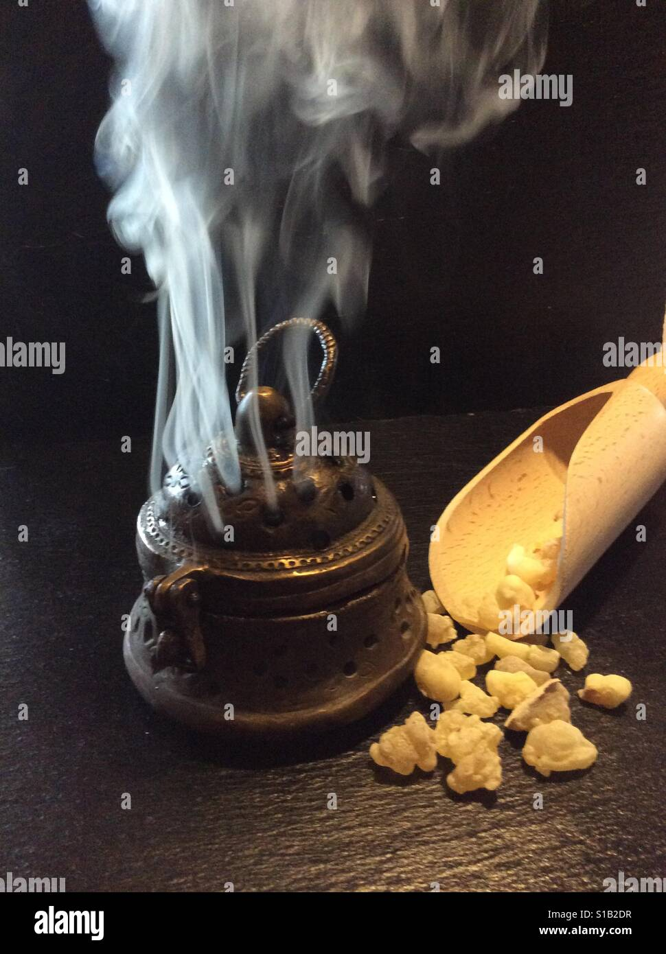 Frankincense from the sultanate Oman and active vintage oriental incense burner - Stock Image