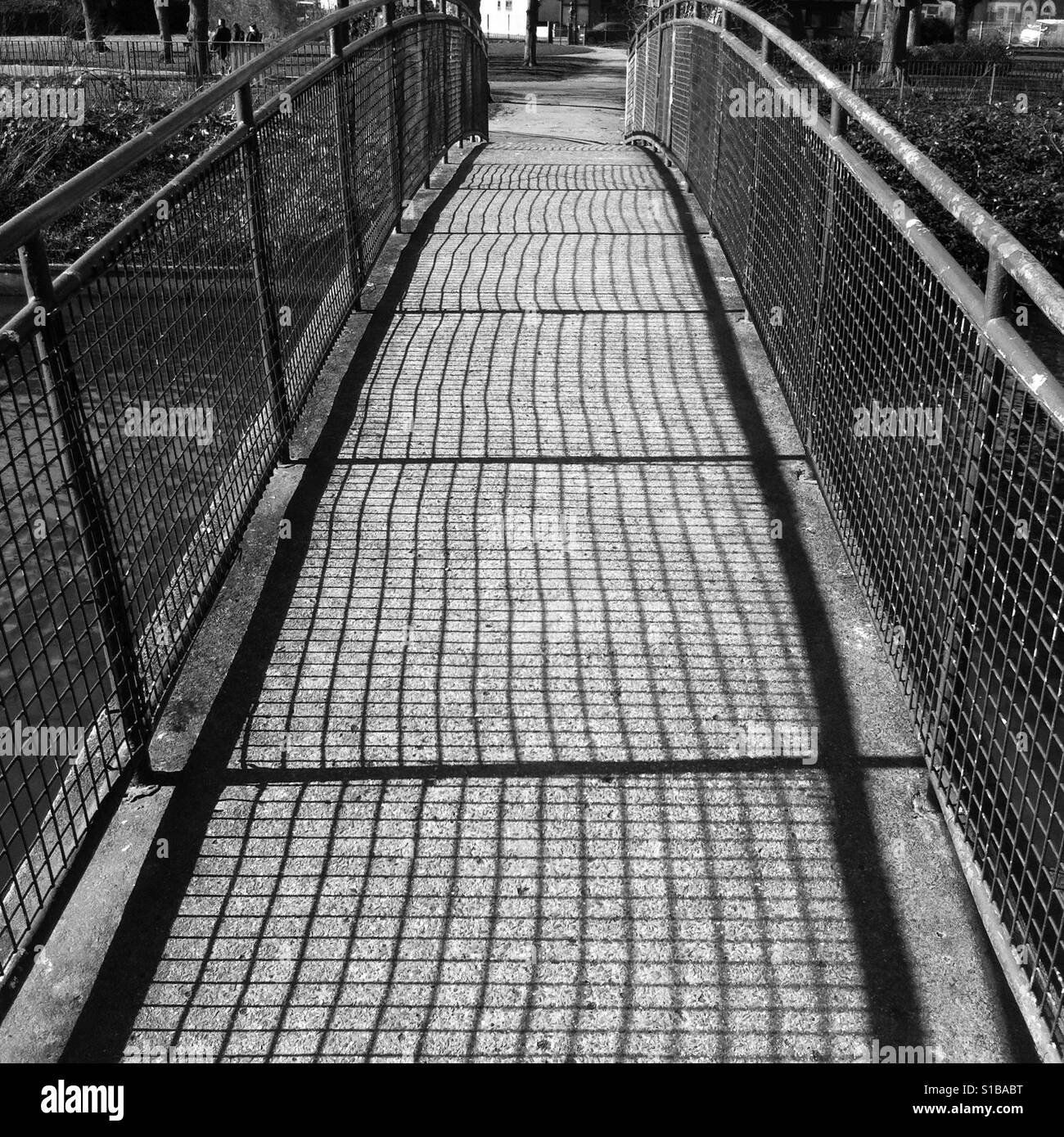 Side lite canal bridge, taken in black and white. - Stock Image