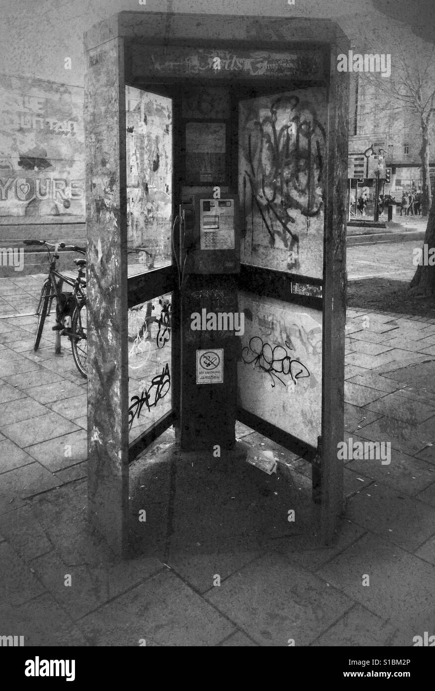 A grungey photograph of a vandalised telephone box in Bristol, UK - Stock Image