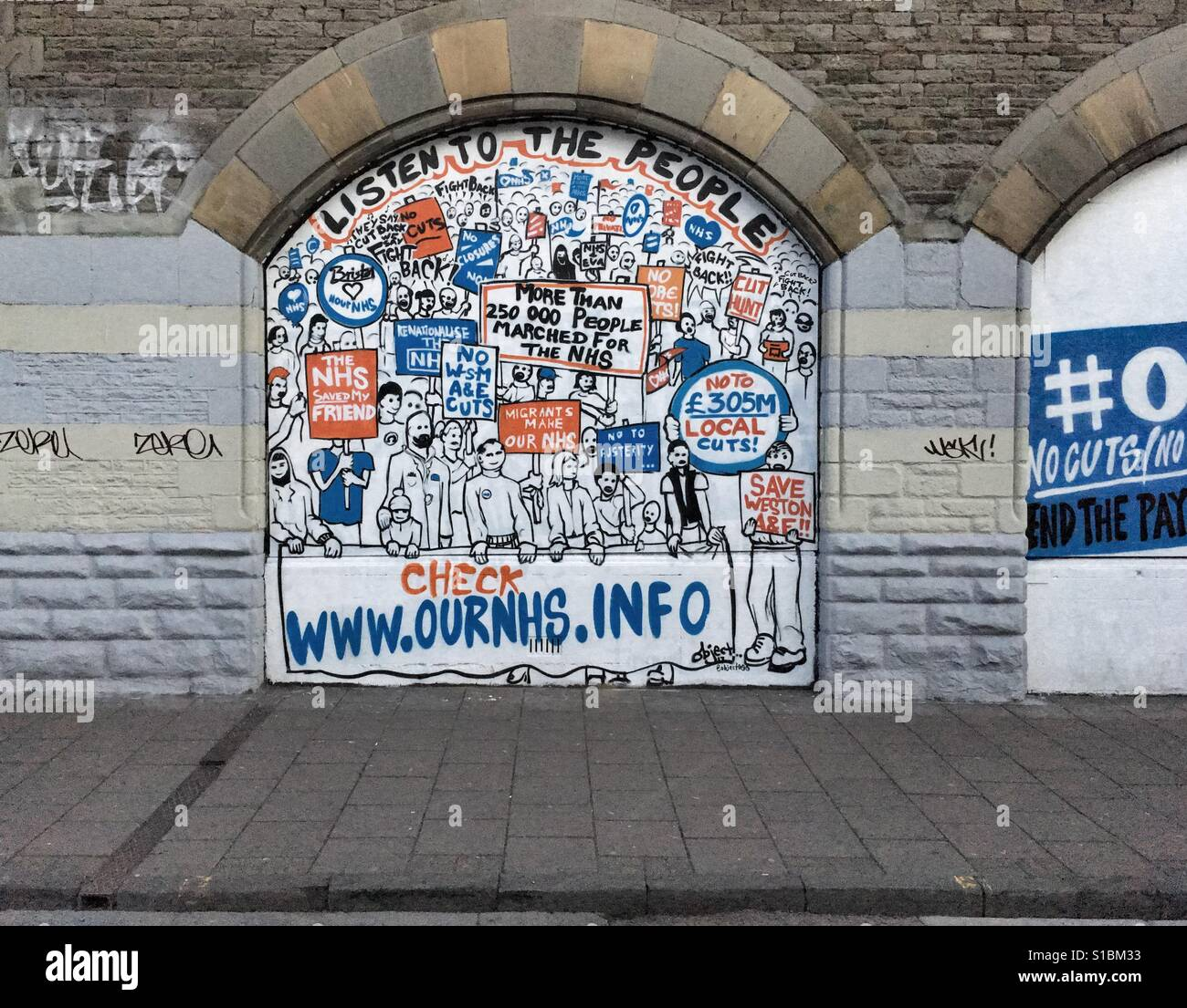 Street art opposing proposed cuts to the National Health Service in Stokes Croft, Bristol, UK - Stock Image