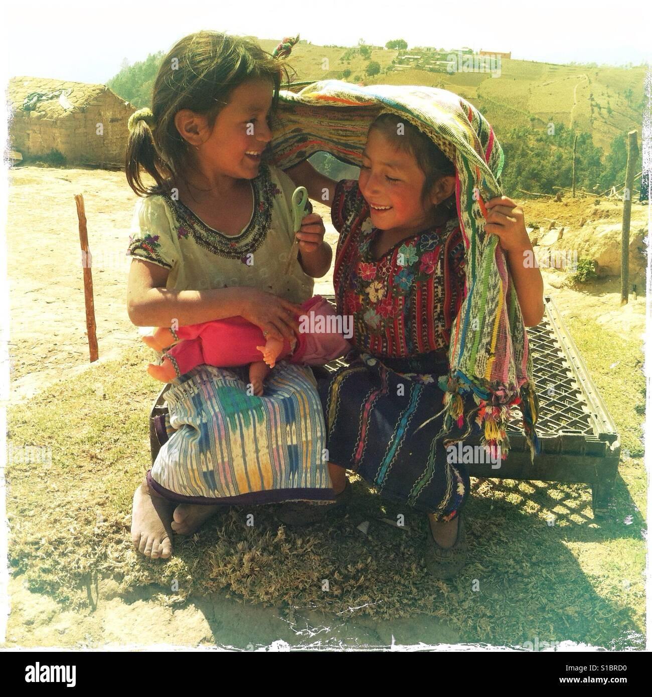 Maya indigenous girls play in Caserio Panuca, Solola, Guatemala. - Stock Image