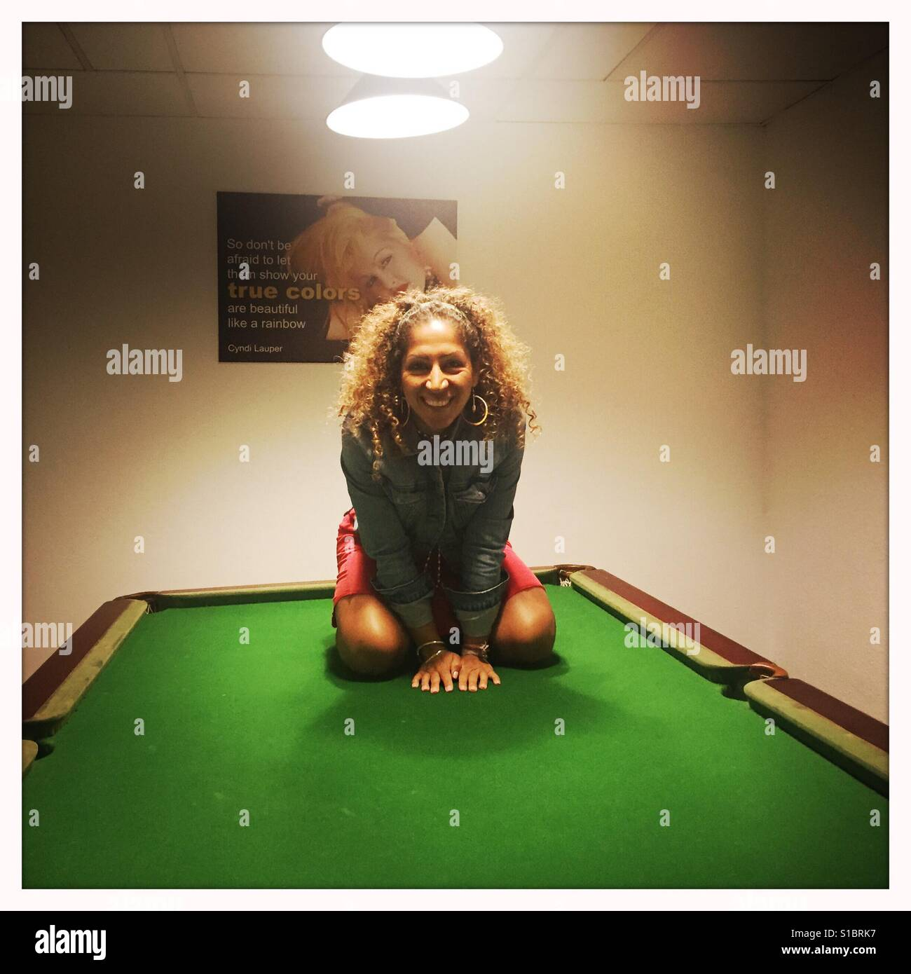 Girl With Curly Long Hair Kneeling On A Pool Table Stock Photo - How long is a pool table