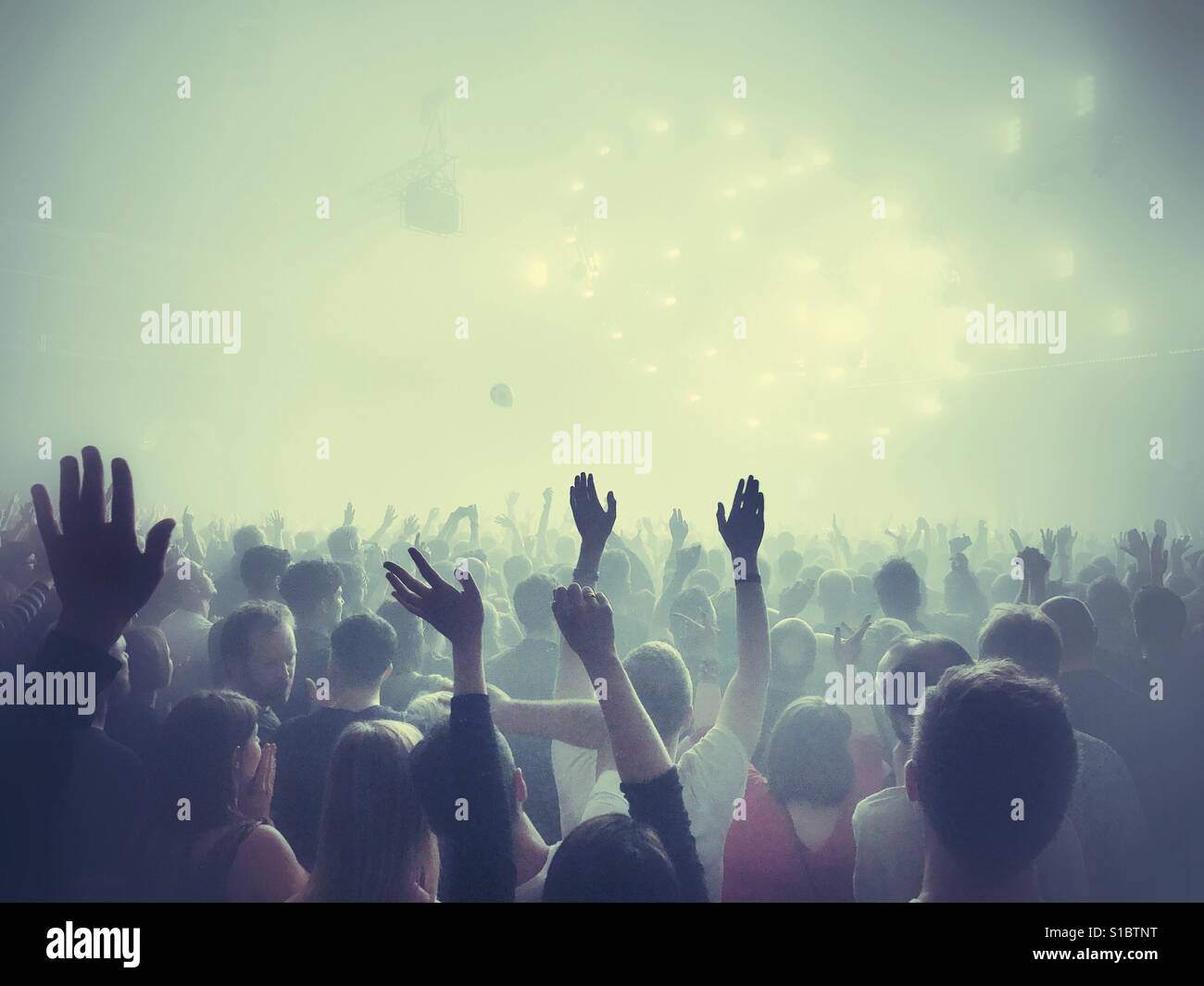 A crowd at a music gig - Stock Image
