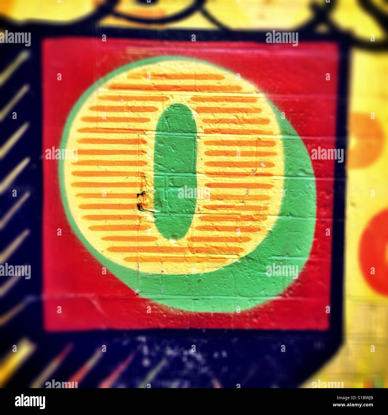Detail from graffiti art by street artist Ben Eine, showing a colourful, stylised letter O. - Stock Image