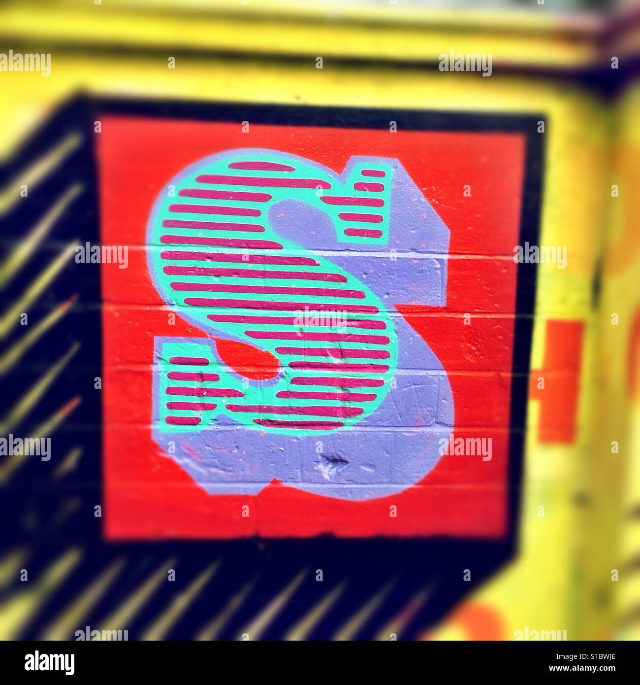 Detail from graffiti art by street artist Ben Eine, showing a colourful, stylised letter S. - Stock Image