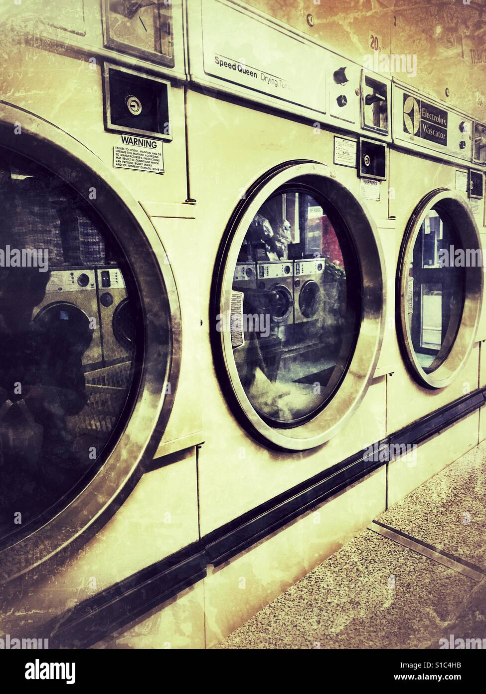 A row of dryers in a Laundrette - Stock Image