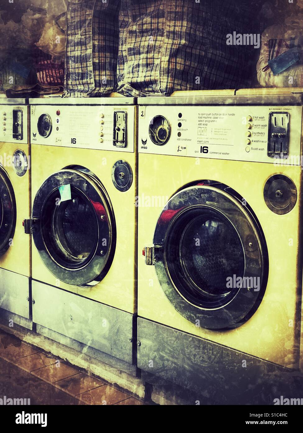 Washing machines in a launderette - Stock Image