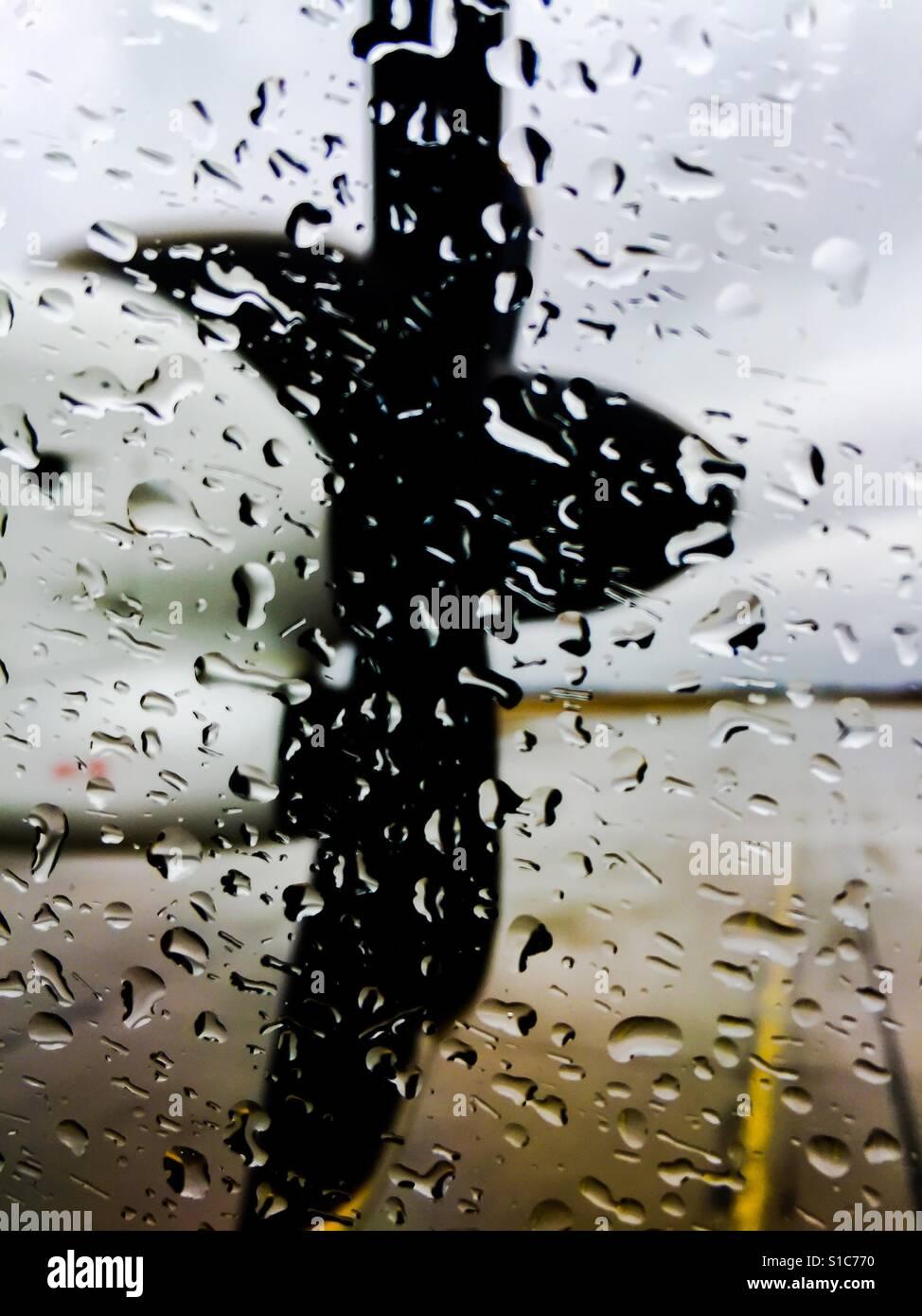 Raindrops on Turboprop window - Stock Image