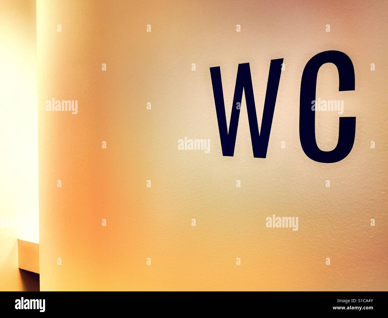 WC sign on entrance door to public bathroom, USA - Stock Image