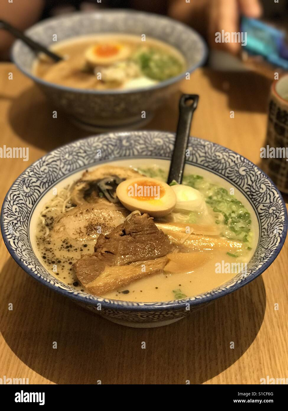 The Grand Tonkotsu Ramen- thick Tonkotsu soup base+thin chewy ramen+runny egg+3 type pork - Stock Image
