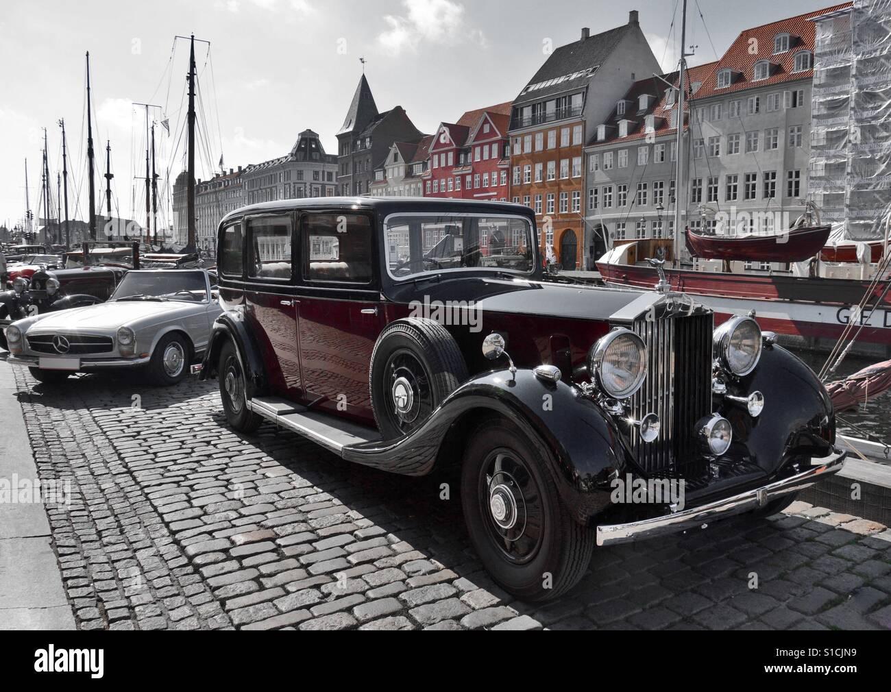 Vintage car at Nyhavn, old waterfront settlement of Copenhagen, Denmark - Stock Image
