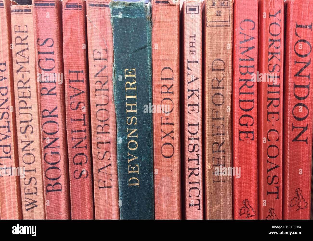 Selection of vintage travel guides to British destinations for sale in street market stall - Stock Image
