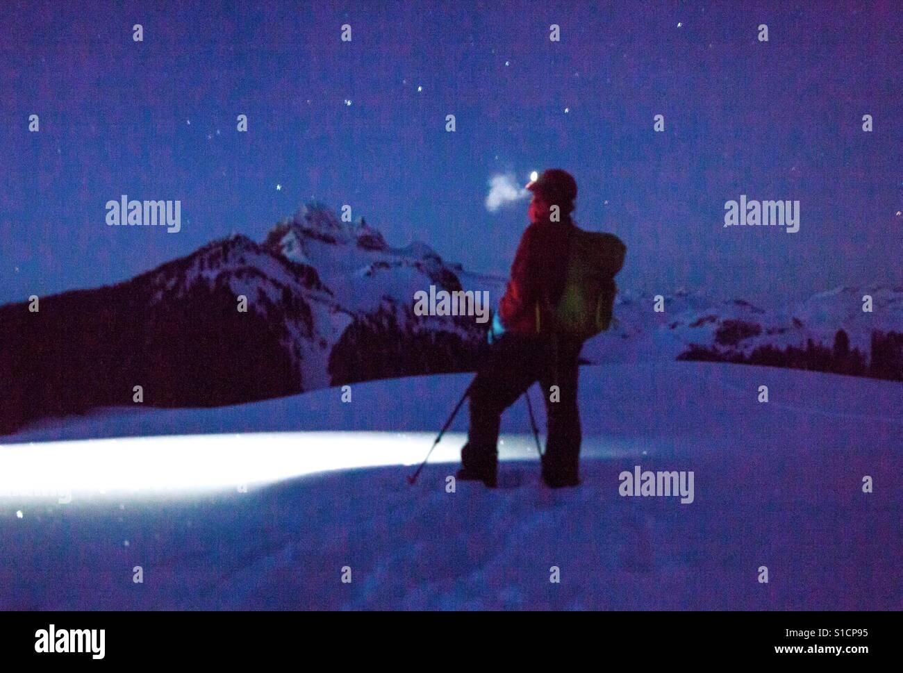 Snowshoeing at night, Elfin Lakes, BC Stock Photo