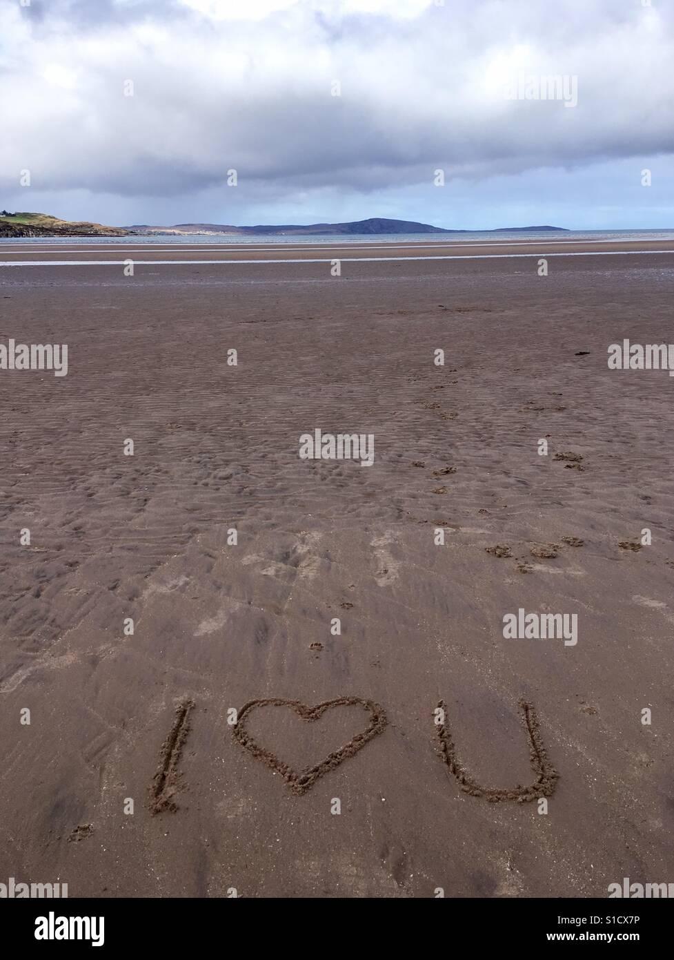 'I love you' written in sand, Gruinard Beach, Webster Ross, Scotland - Stock Image